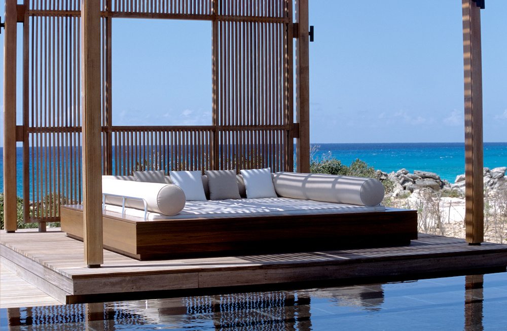 Sit on the daybeds by the pool at Amanyara