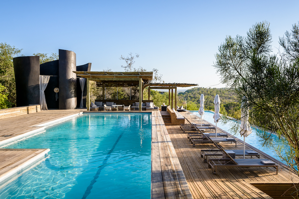 Relax by the swimming pool at Singita Lebombo Lodge