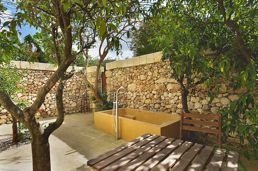 Huge sunken baths on the terrace at Masseria Trapana